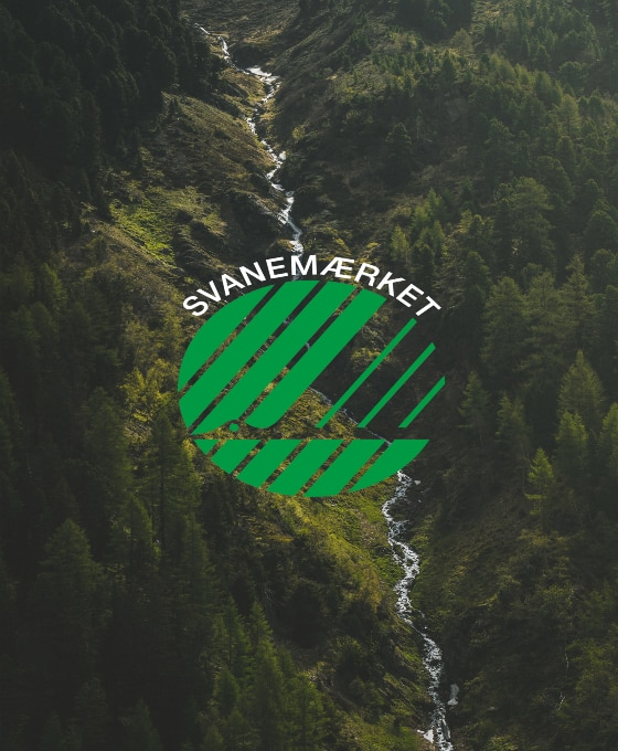 """Picture of a river and a forest with the Nordic Eco Label, """"Svanemærket"""" on top of the picture"""